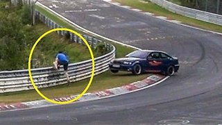 Car Almost Hits Man at Famous German Racetrack - Video
