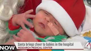 Santa brings cheer to babies in the hospital - Video