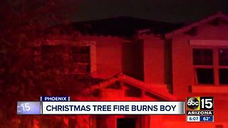 Man helps family escape Christmas tree fire - Video