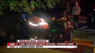 Driver crashes into parked cars, sends car into house in Depew - Video