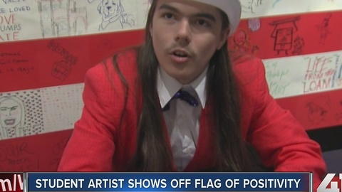 Student artist shows off flag of positivity