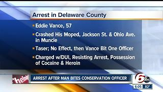 Man arrested on drug charges after biting conservation officer - Video