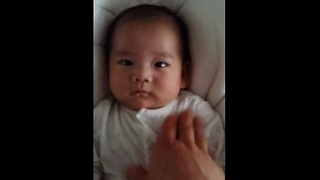 Adorable 6-week-old infant smiles for camera - Video