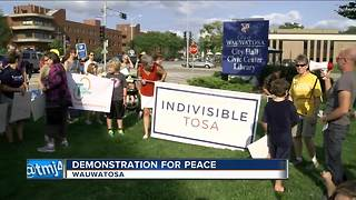 Hundreds come out in Tosa with message of peace - Video