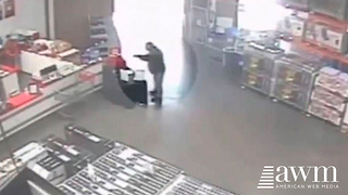 Armed Robber Enters Store Ready To Do Damage, Has No Clue Who's Waiting Inside - Video