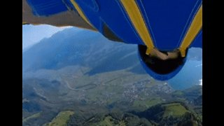 On a Wingsuit and a Prayer, Man Flies Down Swiss Alps - Video