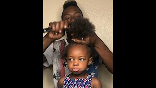 Baby girl has her hair transformed into an afro