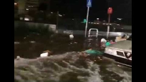 Trash Floats Down Flooded Streets of Rome