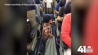 Adorable toddler fist bumps KCI passengers - Video