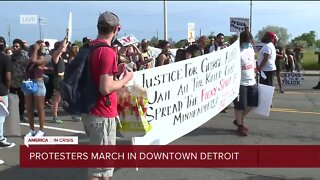 Protesters march in Downtown Detroit
