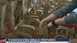Volunteers pack Thanksgiving meals for families