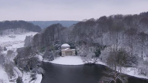 Drone video of world-famous Stourhead gardens enveloped in snow