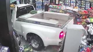 Thieves smash truck through store window, steal ATM - Video