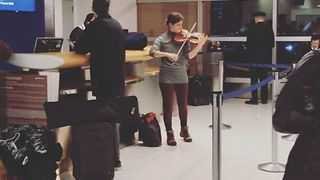 Violinist Plays to Travelers at JFK Airport - Video