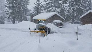 Truckee Resident Uses Heavy Equipment to Clear Fresh Snow from Driveway - Video