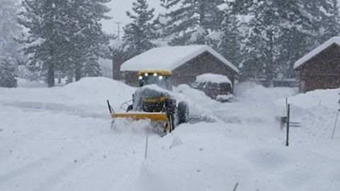 Truckee Resident Uses Heavy Equipment to Clear Fresh Snow from Driveway
