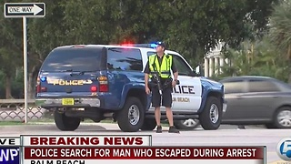 Police search for man who escaped during arrest - Video