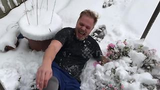 UK man does snow angel and then falls over hilariously - Video
