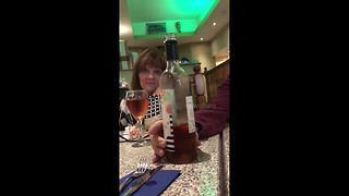 UK man reveals pregnancy to his parents with message on wine label - Video