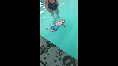 5-Month-Old Knows How To Roll Onto Back In Water