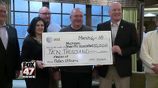 AT&T makes donation to help families of Michigan's fallen officers - Video