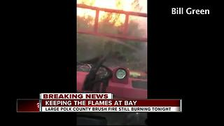 Volunteers help battle large Polk Co. brush fire - Video