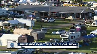 Checking out cars at the 47th annual Iola car show
