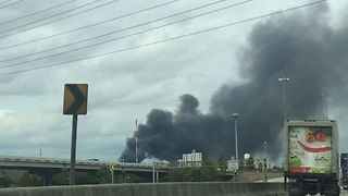 Black Smoke Billows From Houston Recycling Center Fire - Video