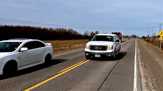 Oncoming truck dangerously squeezes between cyclist and car at high speed
