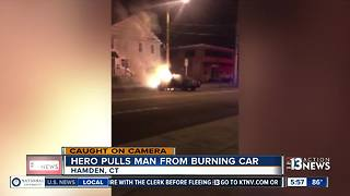 Off-duty firefighter rescues man from burning car - Video