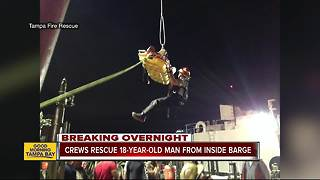 Crews rescue injured worker who fell into barge at Port of Tampa Bay - Video