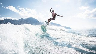Flying surfer – Surfboard levitates above lake