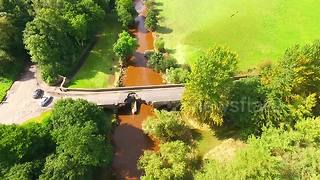 Flood due to major thunderstorm causes road damage in Northern Ireland - Video