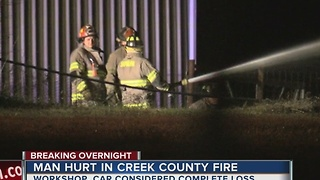 Man recovering after overnight garage fire - Video