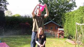 Dad's Bizarre Method of Putting on a Swim Cap - Video