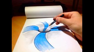 Mind-blowing 'hole in paper' optical illusion - Video