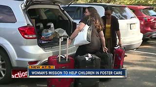 Local woman collecting suitcase donations