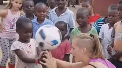 Freestyle Player Brings Joy To Kids By Involving Them In Ball Spinning Trick