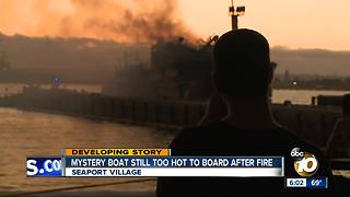 Mystery boat still smoldering after it erupts in a fireball on Friday - Video