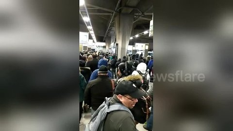 Commuter chaos at George Washington Bridge bus station during snowstorm