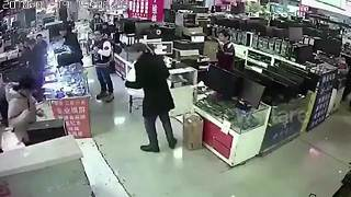 iPhone Battery Explodes In Shop After Customer Bites Into It - Video