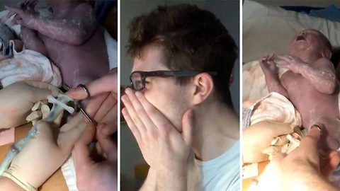 Touching moment new dad sobs with happiness while cutting newborn son's umbilical cord