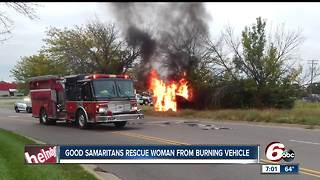 Two teens rescue woman from burning vehicle in Columbus - Video