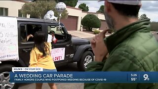 Local couple surprised by family with wedding parade