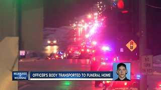 Procession escorts fallen Milwaukee police officer Matthew Rittner's body to Brookfield funeral home