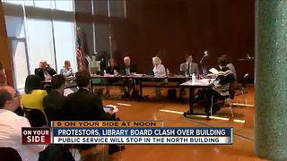 Protesters, library board clash over building - Video