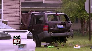 One dead in crash sending vehicle into home - Video
