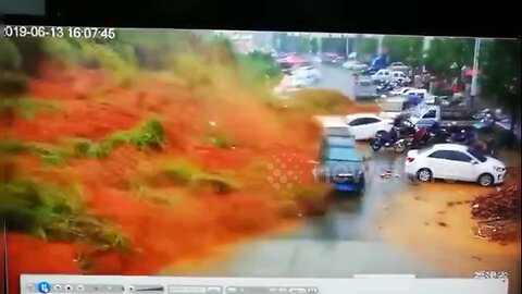 Terrifying moment massive landslide wipes out parked vehicles in China