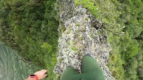 Hawaiian hiker surrounded by stunning scenery tackles nerve-racking narrow ridge