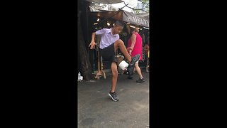 Thai boy shows off soccer skills with toilet roll street performance